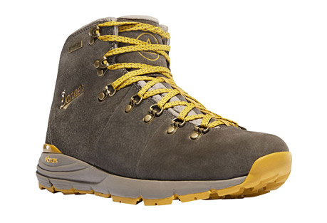danner mountain 600 boots - women's- Save 33% Off - Inspired by decades of legendary hiking boots, Danner partnered with Vibram to forge a new path in hiking footwear. The combination of the Vibram SPE midsole and Fuga outsole gives unparalleled grip on wet and dry surfaces while providing superior cushioning without the weight. Designed to withstand the climate and terrain of the Pacific Northwest, Danner utilized a rugged, waterproof suede upper and Danner Dry waterproof protection. The Mountain 600 defines a new category in hiking boots called Performance Heritage - combining our classic styling with lightweight innovation.  Features:  - Suede Upper: These uppers are made from rich, thick, durable suede  - Danner Dry: 100% waterproof barrier allows moisture to escape without letting water in, keeping your feet dry and comfortable all day long  - Vibram(R) SPE Midsole: This rubberized EVA midsole maintains the same cushioning properties as traditional EVA, but is more durable and won't break down as easily. This technology enhances rebound, comfort and support  - Vibram(R) Fuga Outsole: With its self-adapting lugs and specially formulated Megagrip compound, this outsole provides incredible grip on both wet and dry surfaces  - How it Fits: Designed for versatility, the DPDX has a low profile for everyday wear. Whether on the trail or urban exploring, this last was built to offer enough room for comfort while maintaining a sleek profile. Ortholite footbed included. Please note the Mountain 600 fits slightly large and we recommend sizing down a half size for best fit  - Weight: 30 oz per pair  - Height: 4.5