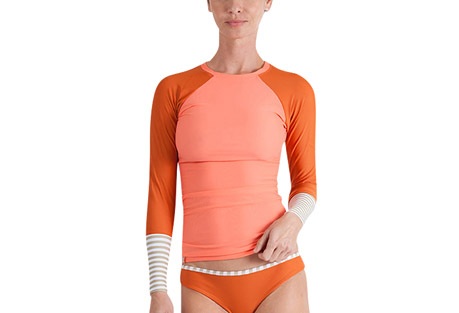 seea doheny rashguard - women's- Save 33% Off - The Doheny Rashguard is a favorite of lady surfers everywhere. The rapidly-changing colors and prints in limited editions are often here and gone in a blink, but you can always count on the signature details that you first fell in love with: color-blocked raglan sleeves, delicate neck opening, and slim-fitting extra long length.  Features:  - Italian nylon/spandex with original prints rated UPF 30+ to 50+  - Extra long and slim-cut body  - Raglan sleeve  - Contrast cuff  - Elastic hem on neck  - Made in sunny California