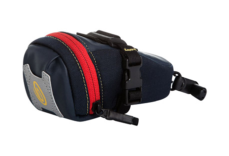timbuk2 bike seat pack xt - medium- Save 53% Off - New and reinvigorated, the Timbuk2 Seat Pack has been revolutionized. The result is the Seat Pack XT. The XT has Timbuk2's signature wide-mouth opening for quick and easy access, blinky light attachment and reflective hits for safe night riding, plus waterproof accents and a new attachment system. The bungee seat post attachment is a synch to use and the accompanying SR buckle makes it easy to attach to rails and adjust until you're comfy. You'll want to ride it everywhere.  Features:  - Wide mouth opening allows quick access  - Bungee and keeper attachment fit multiple sized seat posts  - Easy and secure on-off bike attachment - adjustable SR buckles attach to rails in multiple positions  - In-pocket key keeper  - Reflective hits  - Alternate images may show different colorways, yet accurately display product features  Dimensions:  - Size: Medium  - Top Width: 8.3 in / 21 cm  - Bottom Width: 6.7 in / 17 cm  - Height: 3.9 in / 10 cm  - Depth: 2.8 in / 7 cm  - Weight: 0.2 lbs / 0.1 kg  - Volume: 31 cu in / 0.5 L
